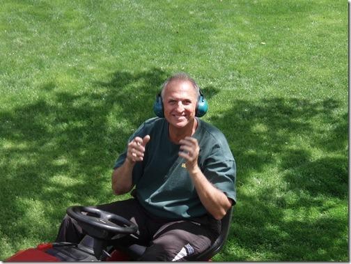 dad on lawnmower