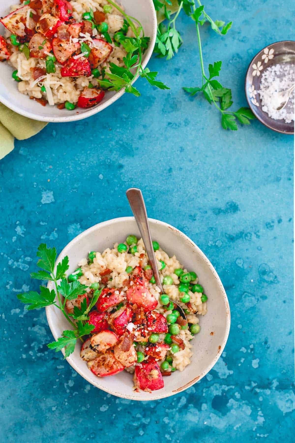 Citrus infused creamy arborio rice is tossed with fresh spring peas and Meyer lemon dijon roasted radishes. Topped with crumbly bacon and freshly grated parmesan, this is risotto is spring comfort food at its best!