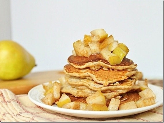 These pear pancakes are filled with cinnamon flavor and the perfect healthy fall breakfast. They've got chopped pears inside the pancakes and caramelized pears on top!