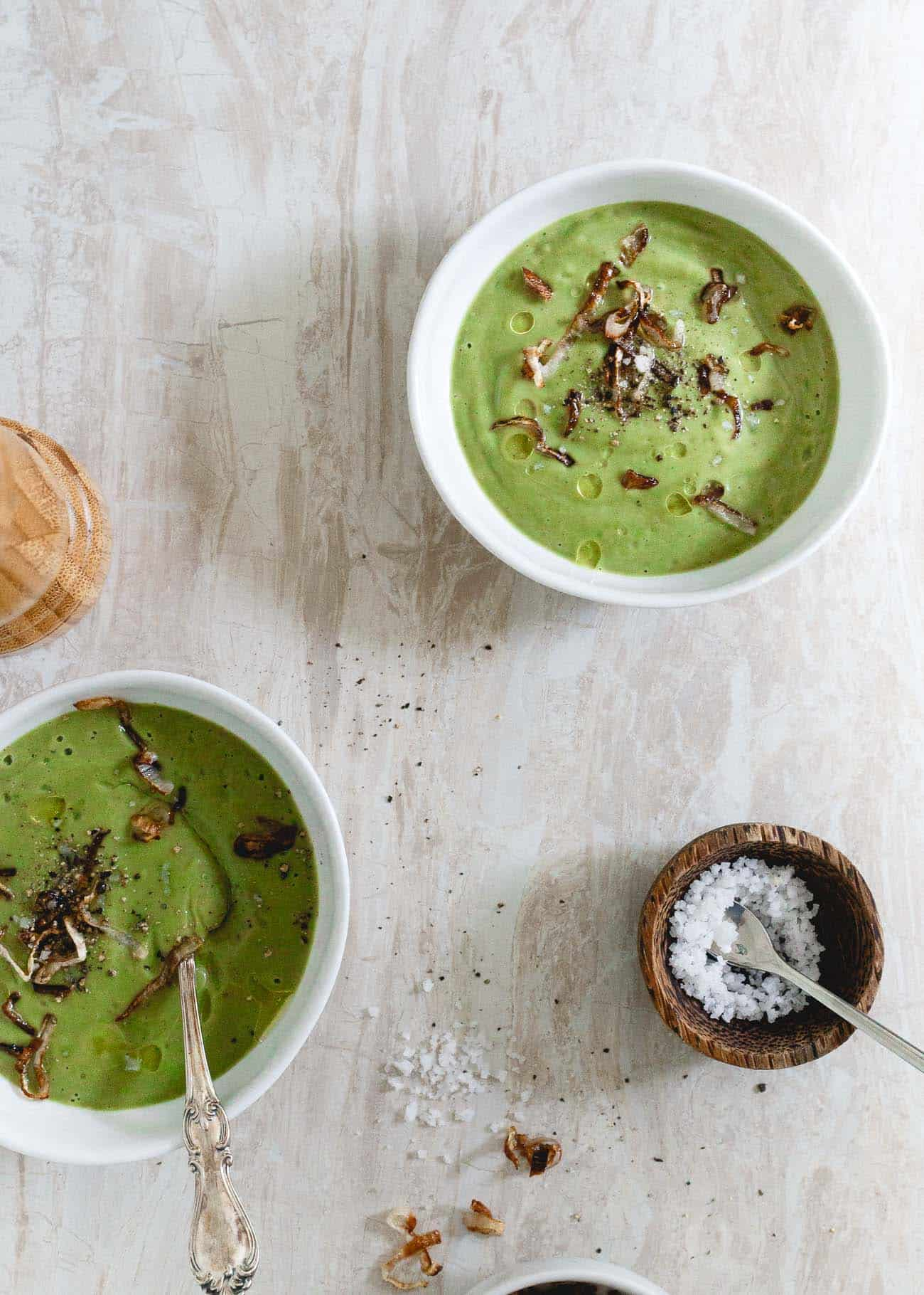 This easy paleo creamy broccoli soup is rich, comforting and topped with crispy shallots. It's also gluten free, vegetarian and vegan.