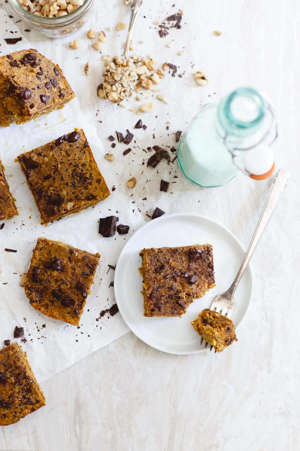 Chewy, walnut packed pumpkin chocolate chip bars are a great snack or healthy dessert.