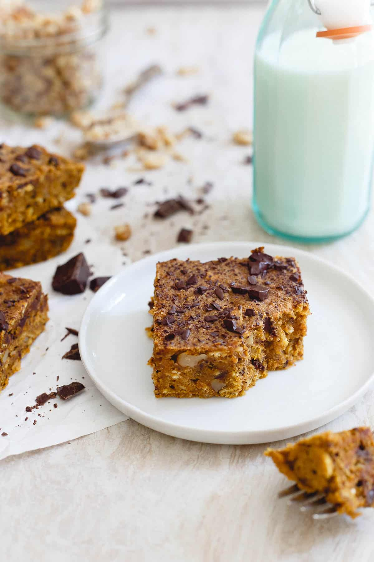 Chewy, dense and packed with chocolate and walnut, these pumpkin bars are a great fall dessert.