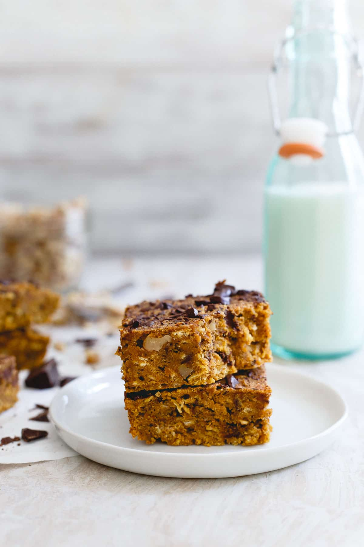 You'll love the chewy, dense bite of these pumpkin walnut chocolate chip bars for the perfect fall sweet.