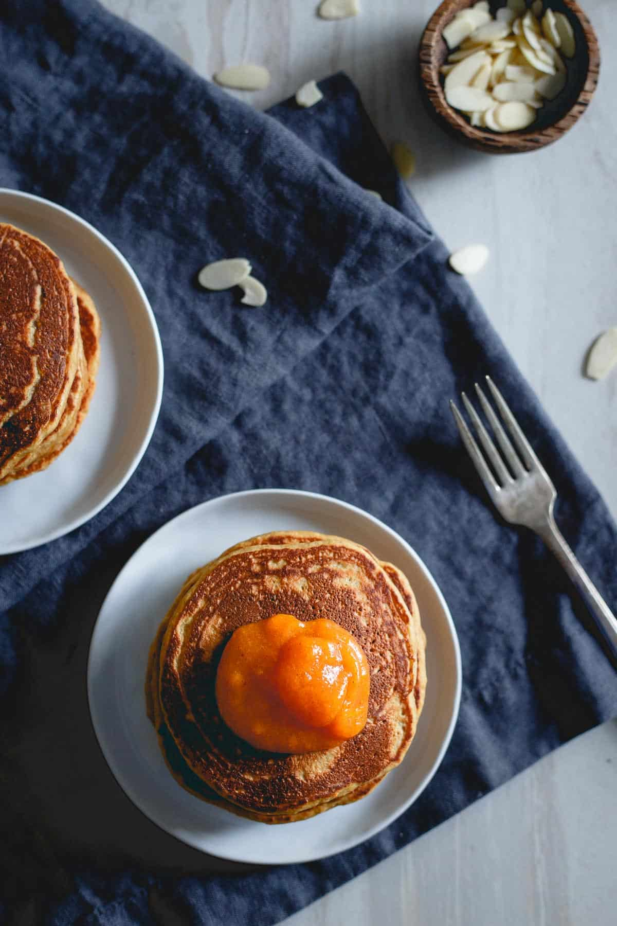 These persimmon pancakes are made with the pulp of the sweet persimmon fruit and full of almond flavor. They're a delicious winter breakfast!