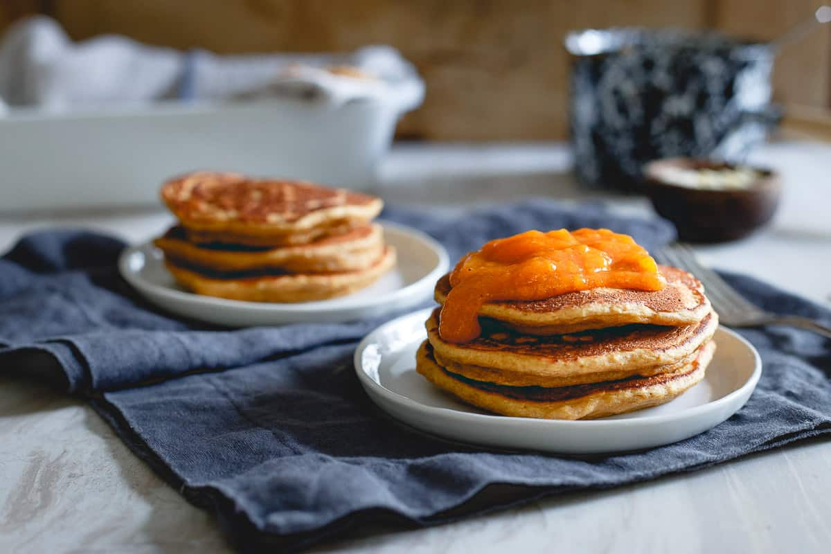 Almond persimmon pancakes topped with persimmon puree are the best way to do breakfast on a cold winter morning.