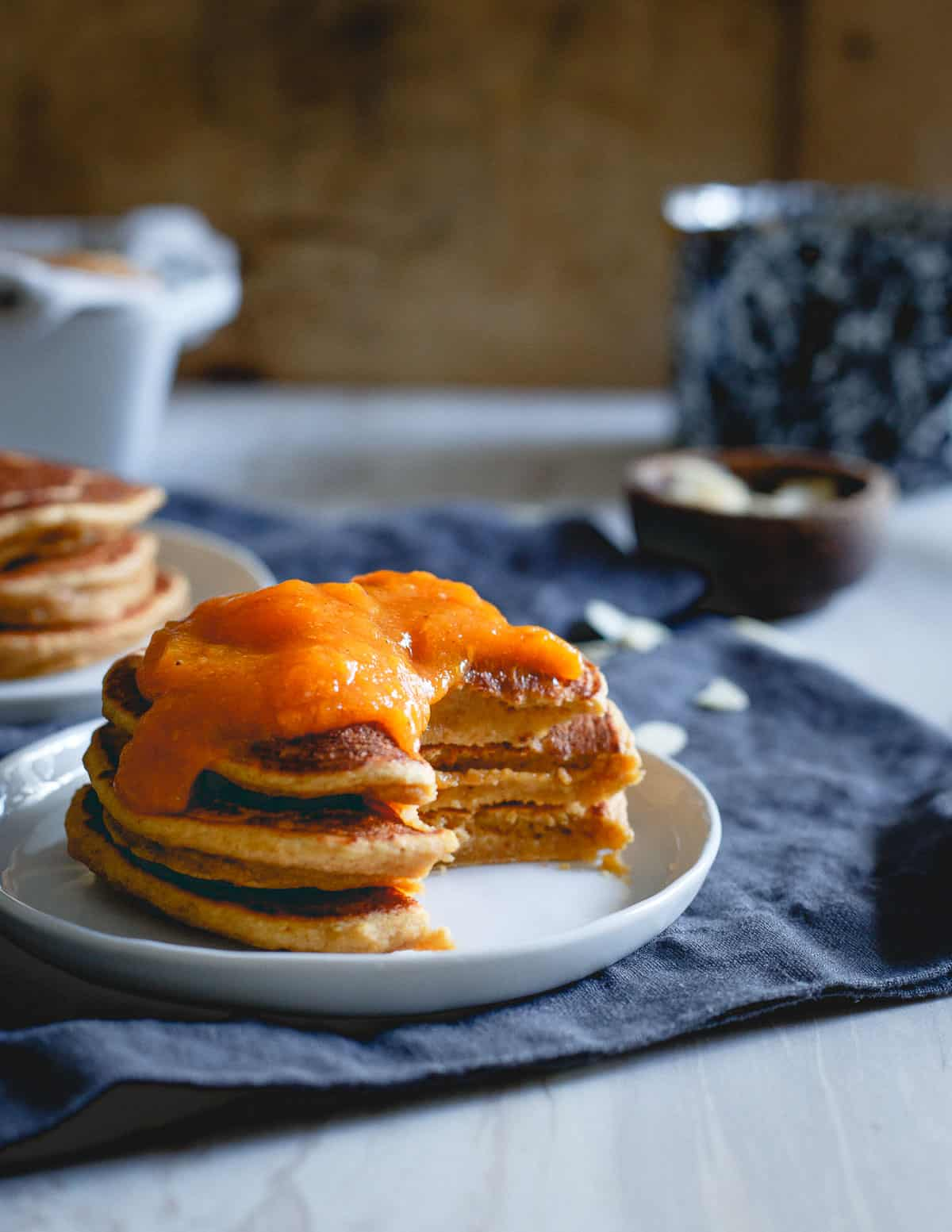 This stack of almond persimmon pancakes is full of flavor, slightly sweet, hearty and perfect for a winter breakfast.