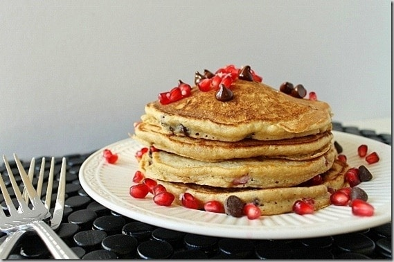 Festive pomegranate pancakes with chocolate chips make a great winter breakfast.