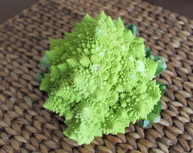 Broccoflower is a mix between broccoli and cauliflower and turns into an easy dinner side dish when roasted.