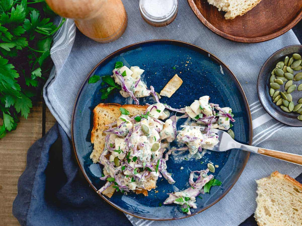 Greek yogurt and dijon mustard give this egg salad that creamy texture you love while green olives, red cabbage and parsley keep the flavor game strong!
