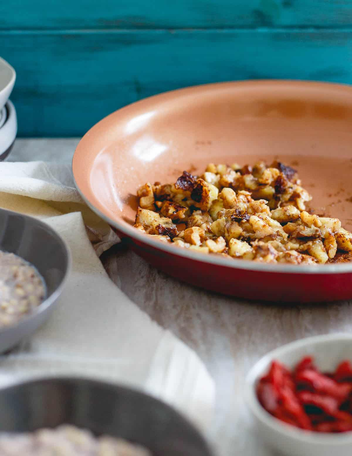 A simple caramelized banana walnut topping makes this warm quinoa cereal a delicious bowl for breakfast.