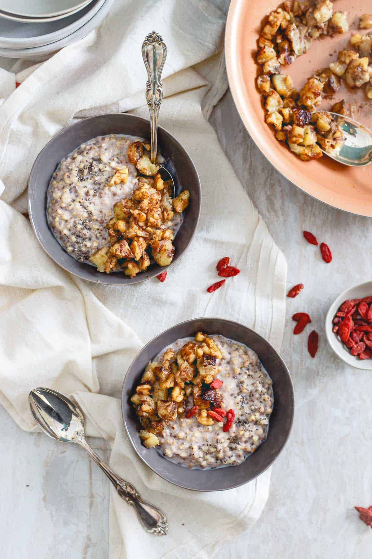This warm breakfast cereal made with quinoa or buckwheat groats is topped with a sweet caramelized banana walnut topping.