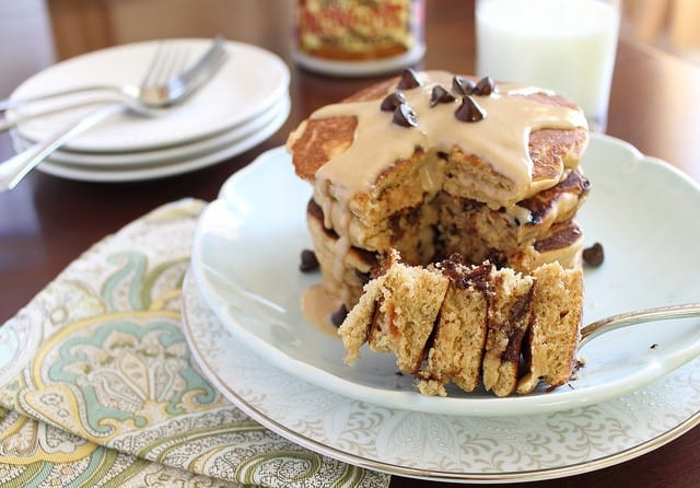 Peanut butter chocolate chip pancakes with peanut butter topping are doughy, fluffy and delicious for breakfast!