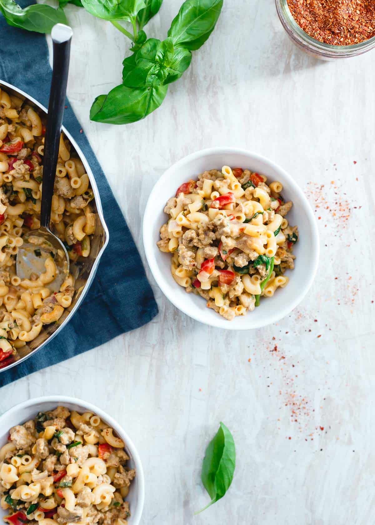 Filled with spinach and peppers and tossed in a creamy read cheddar cheese sauce, this turkey skillet mac and cheese is an easy weeknight dinner everyone will love.