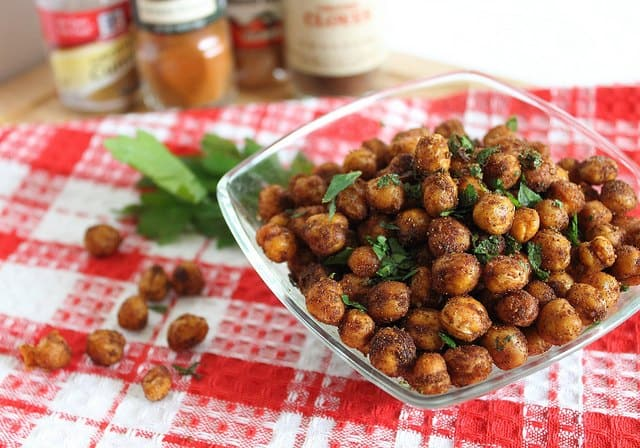 Spicy roasted chickpeas with cinnamon are equal parts savory and sweet and make a delicious healthy snack.