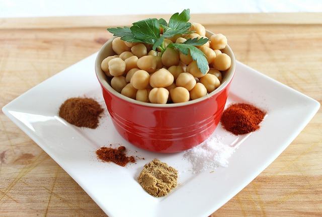 These sweet and savory spicy cinnamon roasted chickpeas make a delicious snack or appetizer.