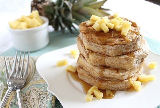 Try a stack of these battered pineapple pancake rings for breakfast, a delicious combination of pancakes and fruit.