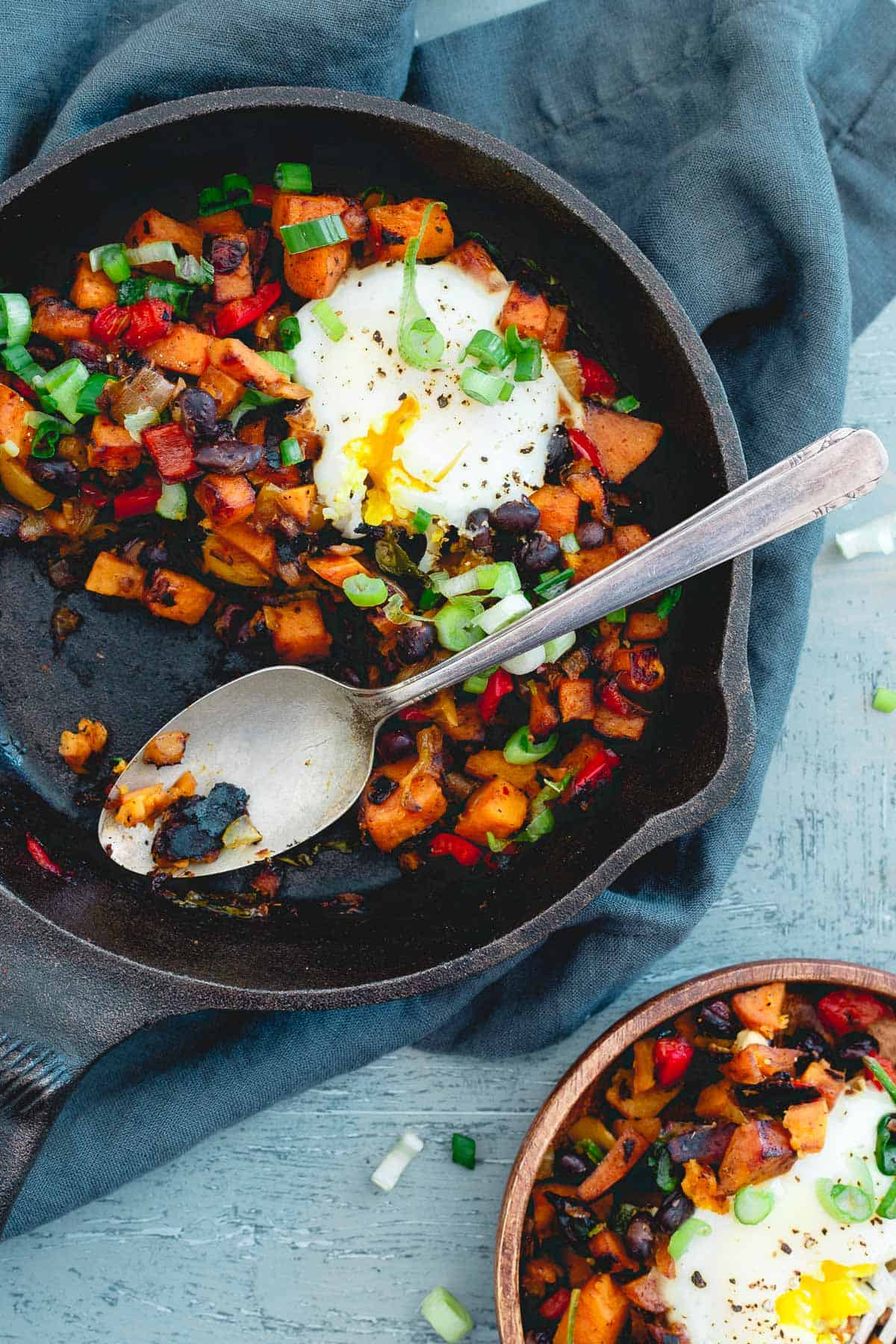 With a couple runny eggs on top, this harissa sweet potato hash is simple, spicy and perfect for a quick meal any time of day!
