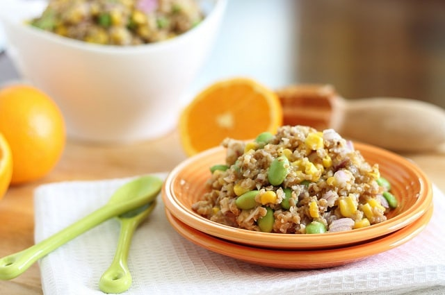 This bulgar wheat salad is combined with a bright orange dijon dressing for a hearty winter salad.