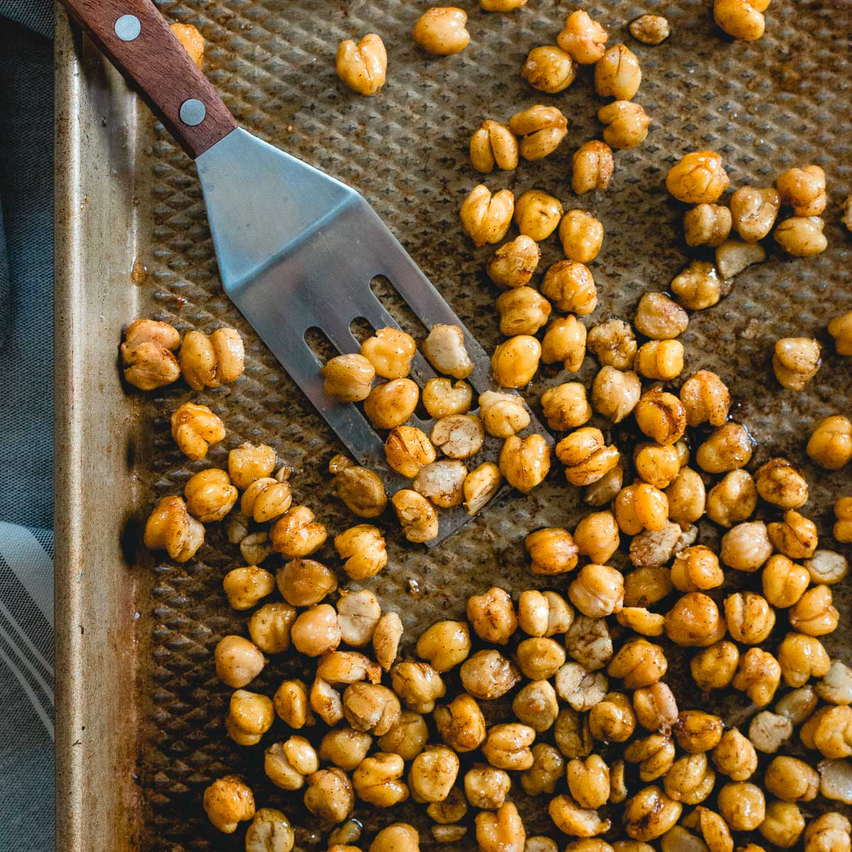 Follow this trick to get crispy roasted chickpeas every time, these cinnamon toast crunch chickpeas are the perfect healthy, sweet snack.