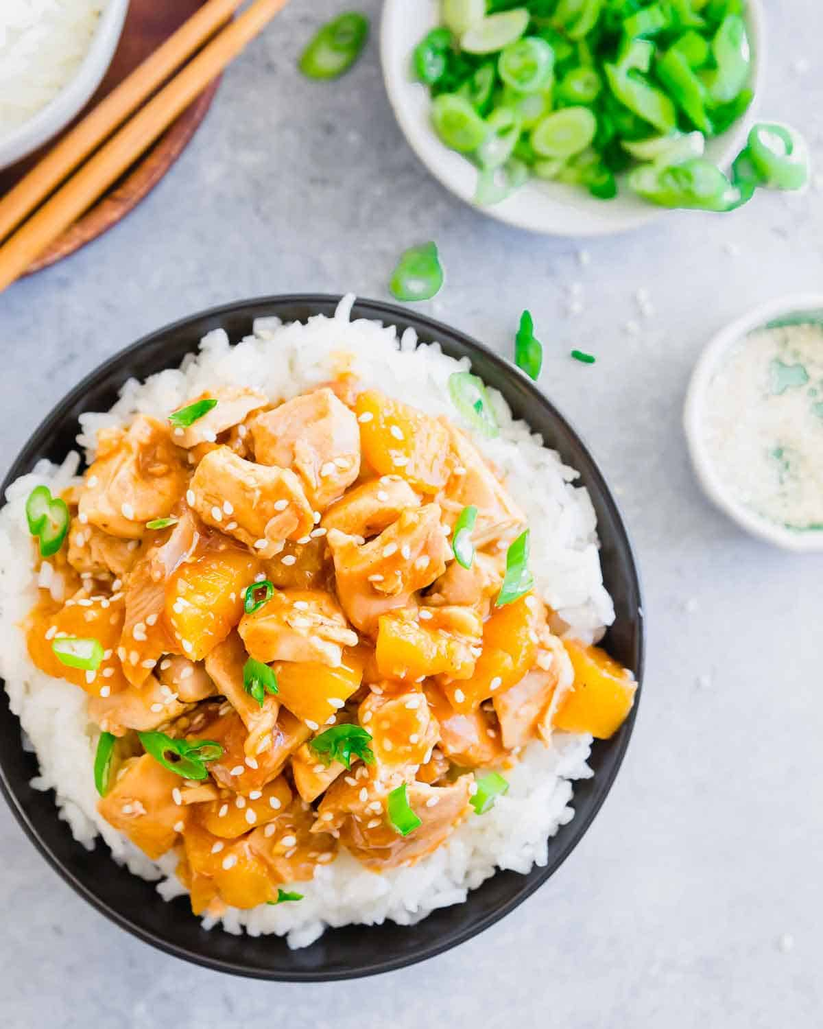 A sweet and stick honey garlic ginger sauce coats chicken thighs and pineapple chunks in this easy slow cooker dinner recipe.
