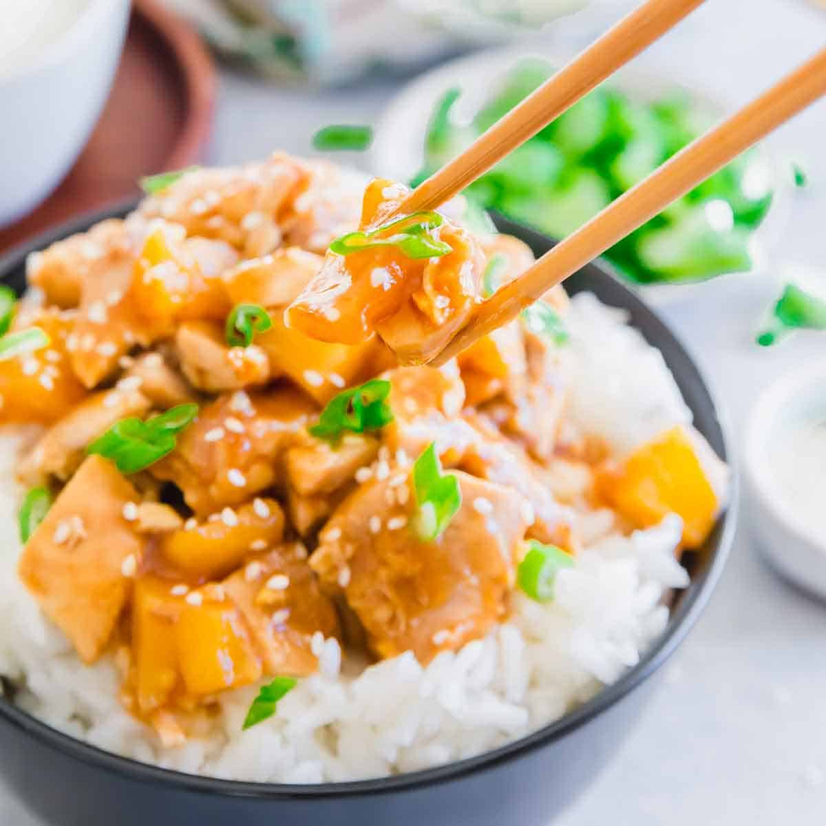 Crockpot honey garlic chicken with pineapple in a sticky, sweet and savory sauce.
