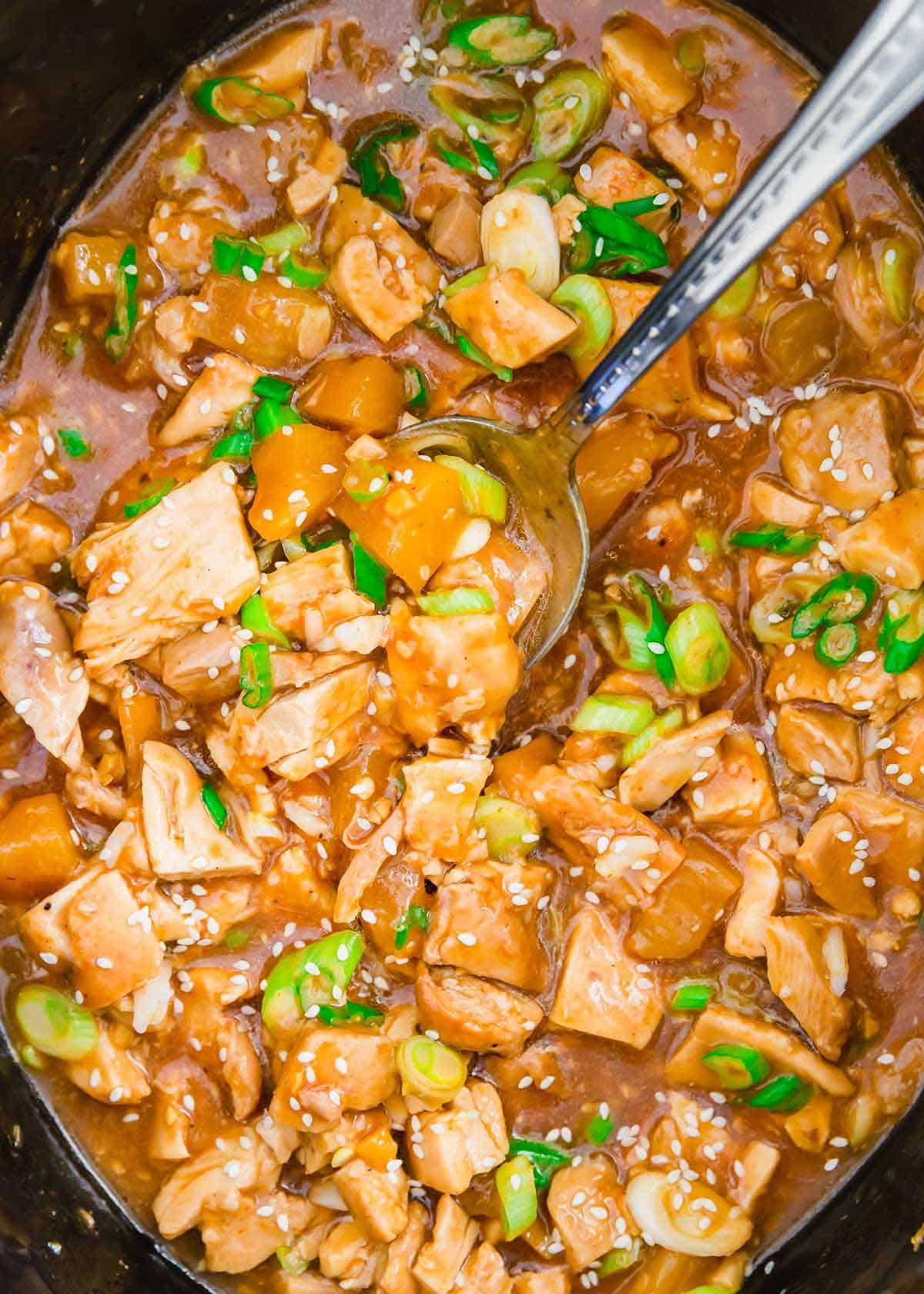 Honey garlic chicken thighs cooked in the slow cooker are a delicious takeout fakeout dinner recipe.