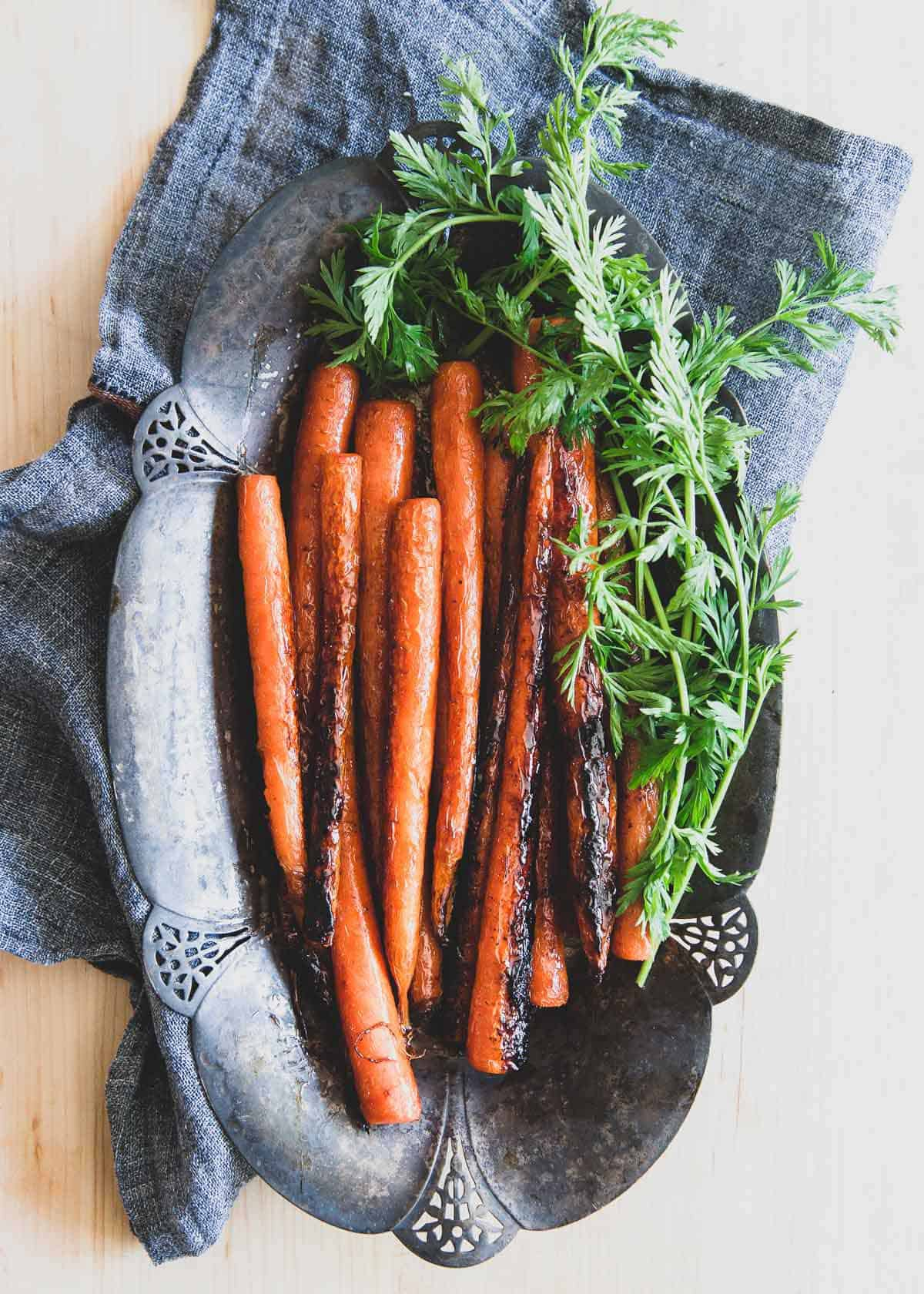 These caramelized candied carrots with brown sugar and butter taste just like candy and are a great tasty side dish to any dinner.
