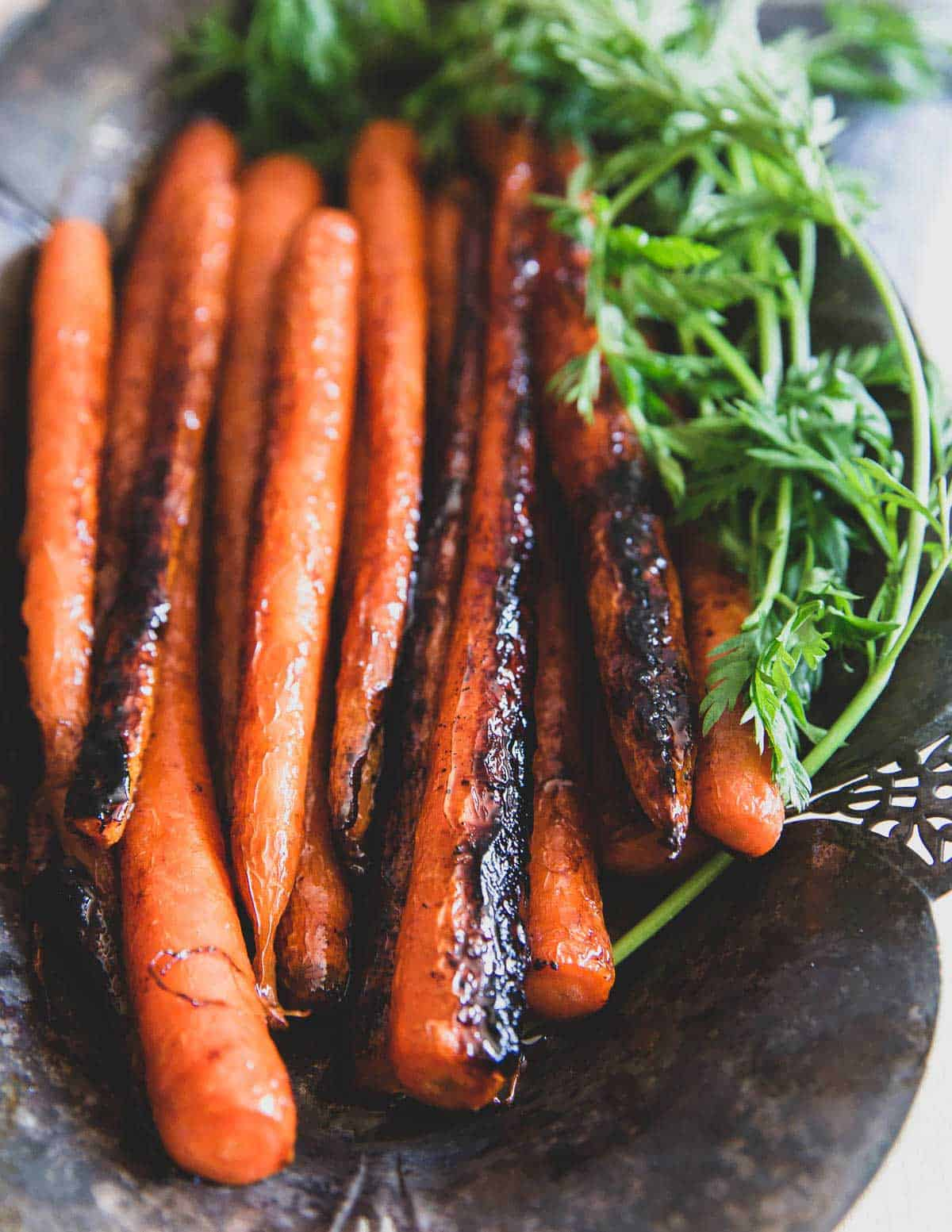 Brown sugar glazed carrots are made in just 15 minutes on the stove top for an easy dinner side dish.