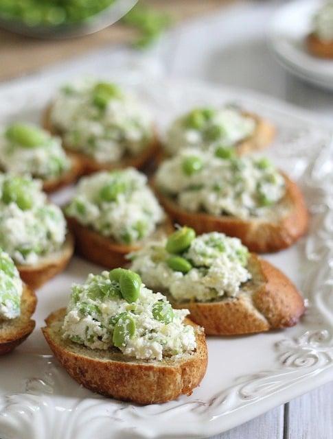Edamame crostini with farmers cheese and lemon