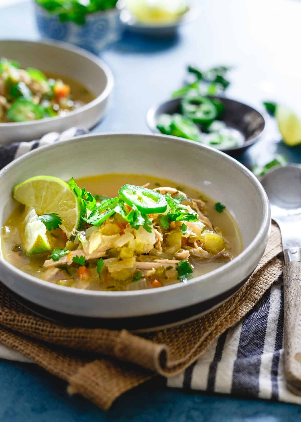 Spicy chicken lime soup is perfectly comforting for winter with a delicious tangy broth.