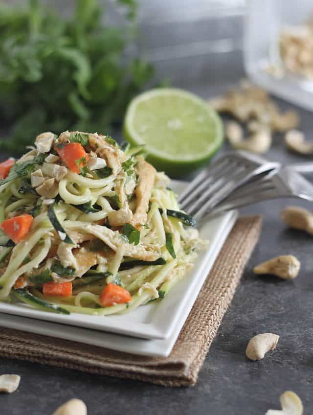 Zucchini noodles are tossed in a flavorful Thai peanut sauce with shredded chicken for a healthier spin on classic Thai noodles.