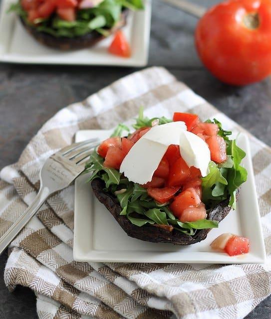Tomato, arugula and ricotta salata stuffed portobellos