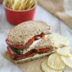 Cream cheese sandwich with tomatoes and basil