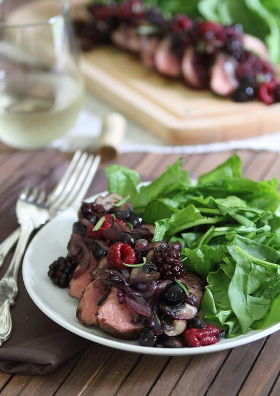 Spice rubbed pork tenderloin with crimini berry sauce