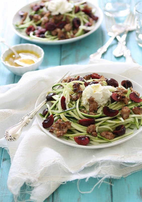 Zucchini noodles with sausage, cherries and ricotta is a healthier way to get your pasta fix in the summer. A delicious combination of savory and sweet.