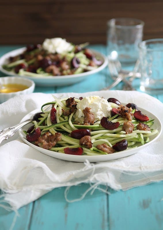 Italian sausage, ripe summer cherries a creamy ricotta combined with zucchini noodles in this lighter summer dish.