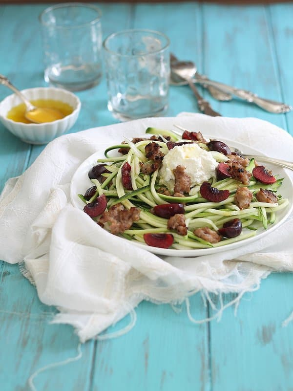 Zucchini noodles are a healthy alternative to traditional pasta in this dish with Italian sausage, cherries and ricotta.