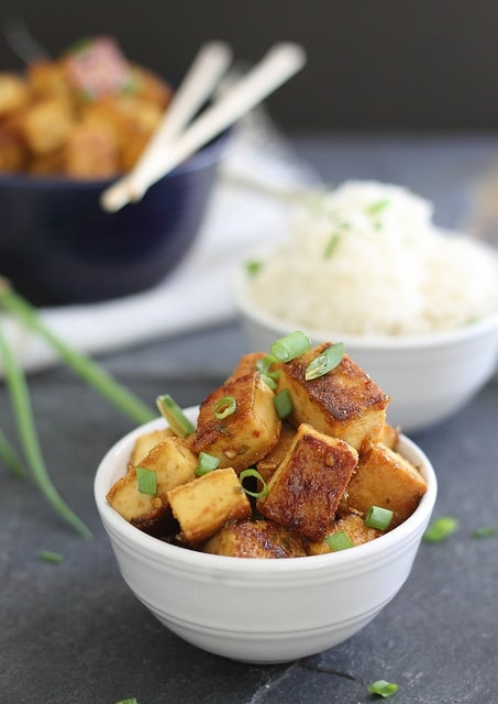Make this sweet and sour tofu in minutes and forget about the takeout! The outside is super crispy and glazed in sweet and sour sauce. Perfect with some white rice.