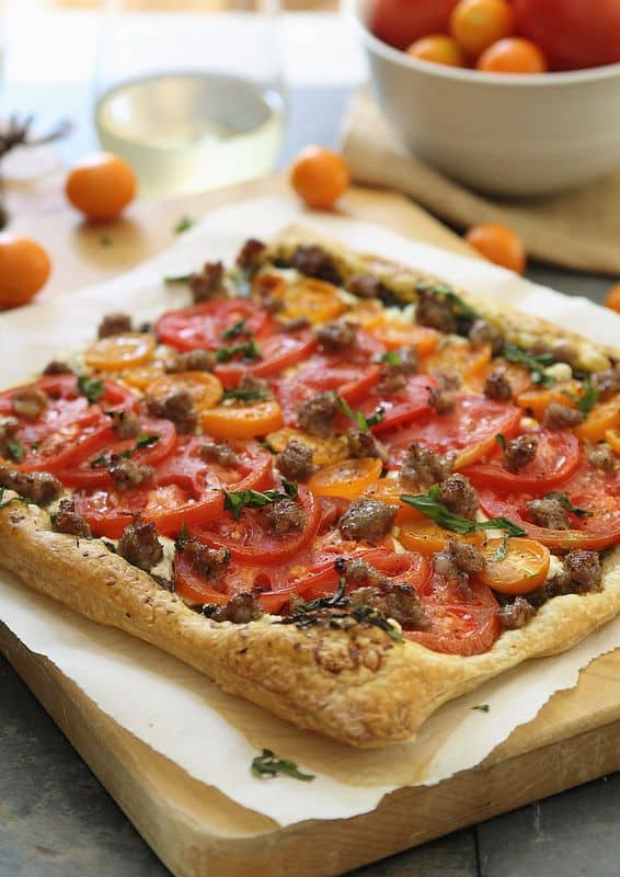 Goat cheese tomato and sausage tart
