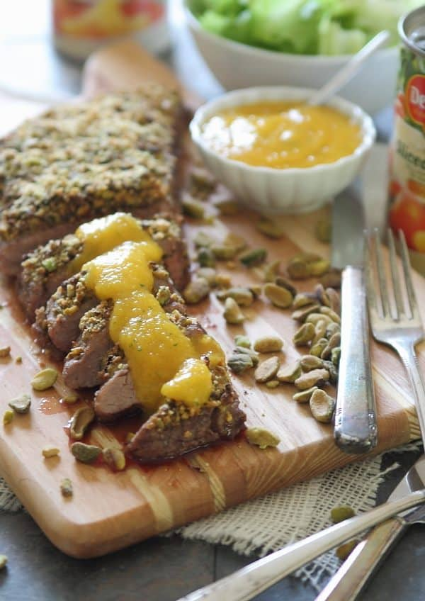 This pistachio crusted flank steak topped with a simple peach puree is an easy way to keep dinner healthy yet delicious.