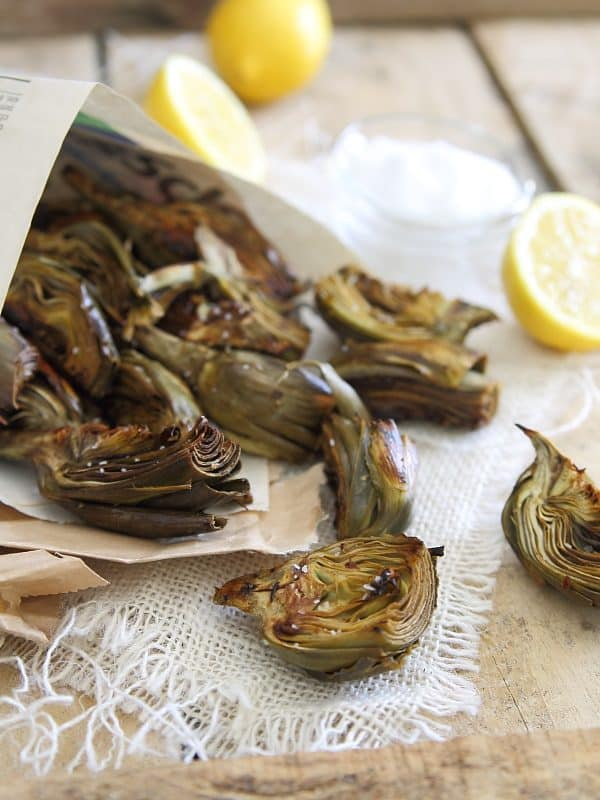 Roasted baby artichokes served with lemon and salt