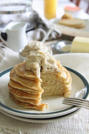 coconut ricotta pancakes with caramelized banana creme fraiche butter