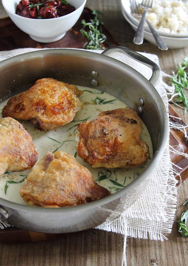 Fried chicken with goat cheese and cherry tarragon sauce