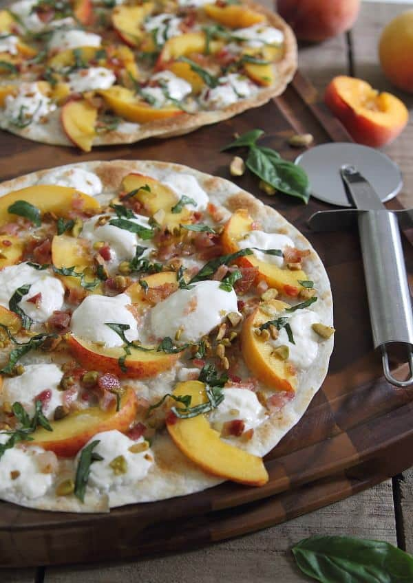 Peach burrata bacon quesadilla with pistachios and basil