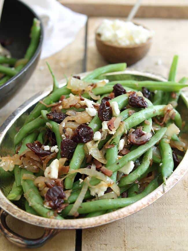 Green bean cherry salad with caramelized onions and crispy ham