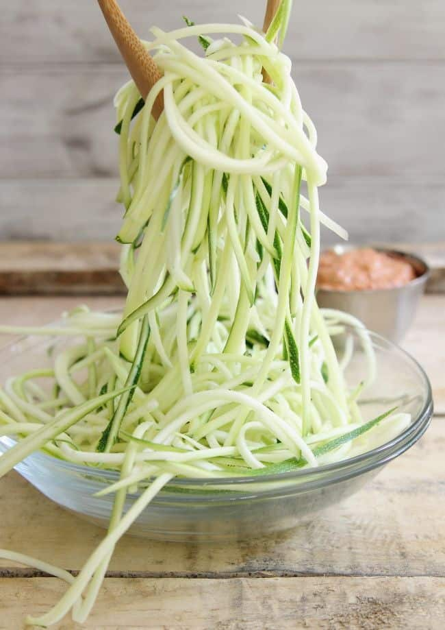 Zucchini noodles with creamy roasted tomato sauce is an easy, healthy meal perfect for summer.