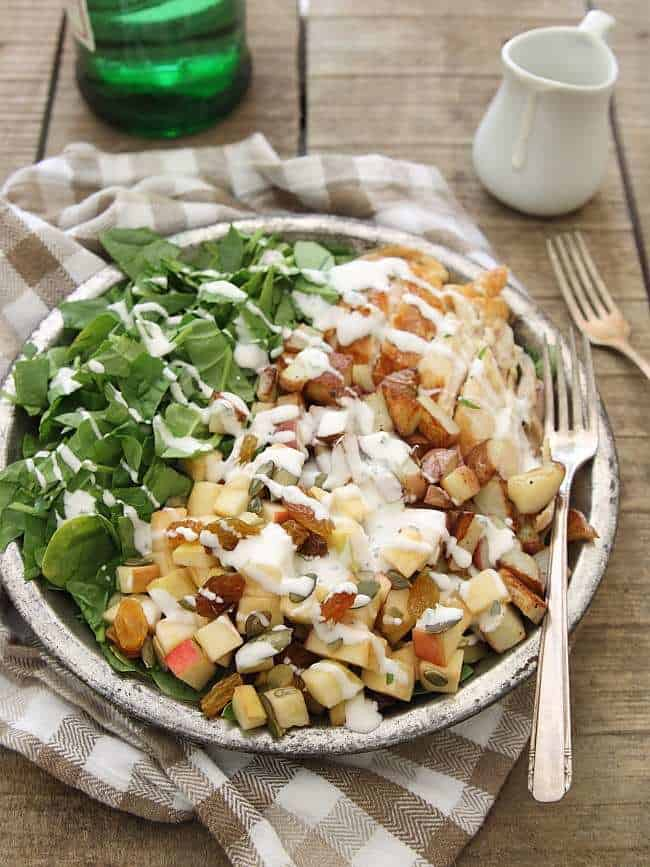 Chopped spinach blue cheese chicken potato and apple salad