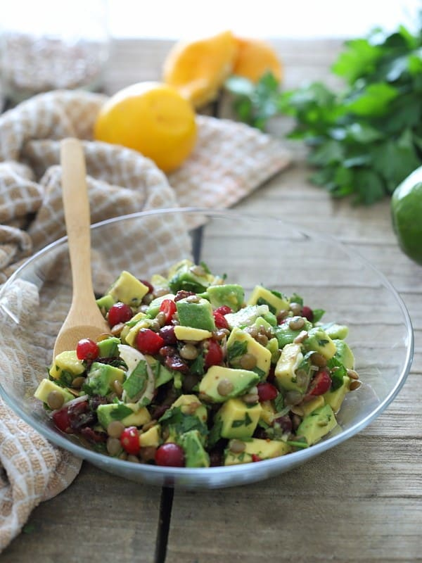 This salad is packed with healthy fats from a good dose of avocado. Cooked lentils and both fresh and dried cranberries are tossed with a lemon dijon dressing to make this a hearty lunch or side salad.