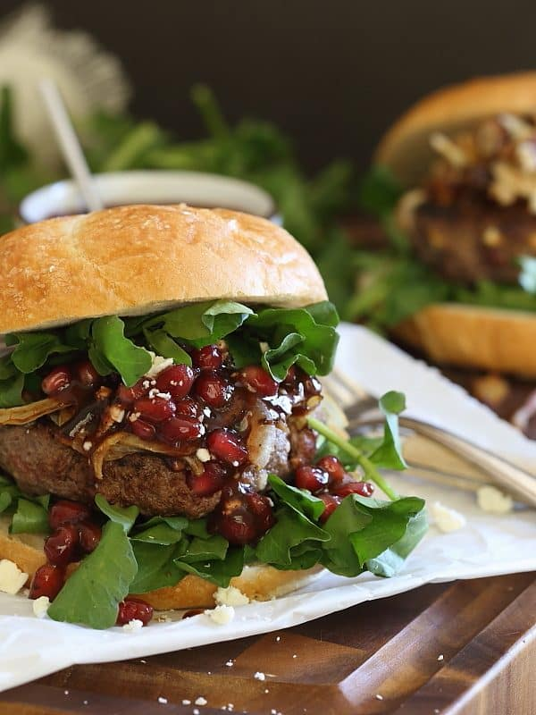 These bison burgers are filled with pomegranates and feta cheese and topped with caramelized onions and a quick pomegranate sauce.