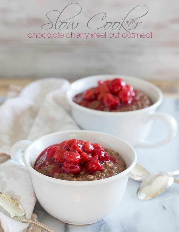 This slow cooker chocolate cherry steel cut oatmeal is waiting for you when you wake up in the morning. Start your day with a delicious comforting bowl for breakfast.